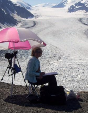 Angie  McIntosh painting at the Salmon Glacier in Northern BC