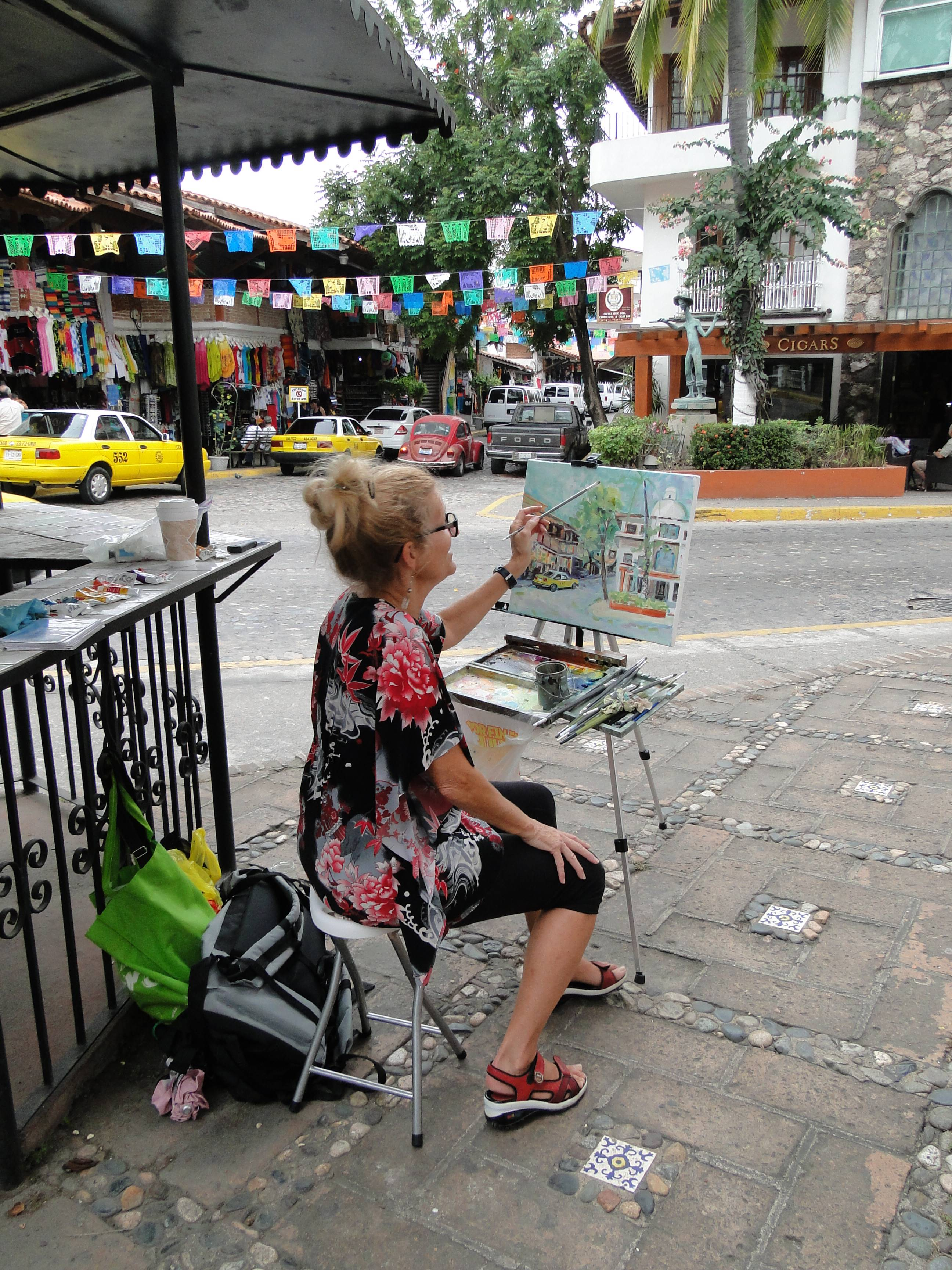 Angie Roth McIntosh painting                                       in Municipal Market in Puerto                                       Vallarta Mexico