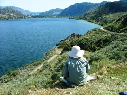 Joanne Beaulieu contemplating the scene by Skaha Lake