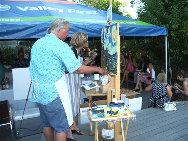 Angie and Glenn Clark painting at Starry Starry Night 2008