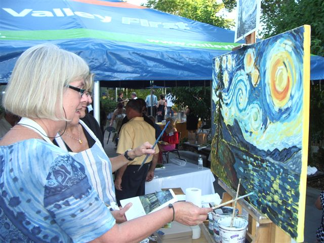 Nel Witteman working on Starry Starry Night painting
